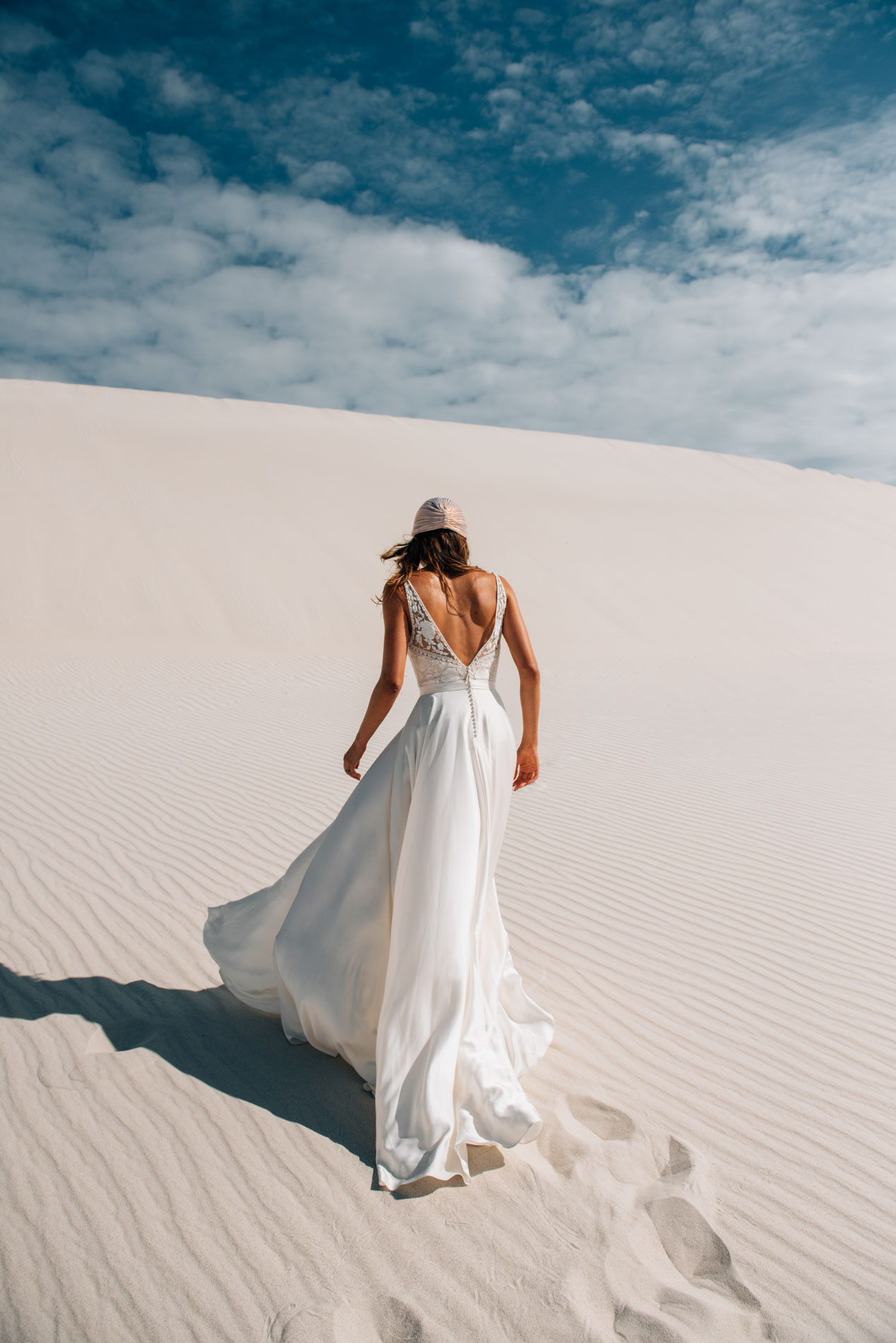 Mitra gown on gorgeous brides in sand dunes, come to Hannah Elizabeth Bridal at November bridal event